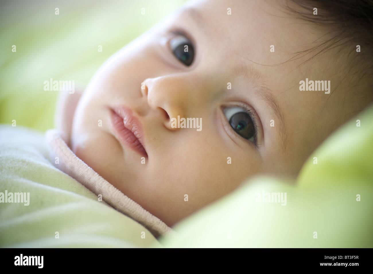 Baby girl looking back - Stock Image