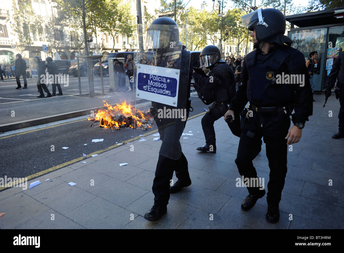 Riot police in the clashes at the Barcelona city centre during the general strike in Spain. - Stock Image