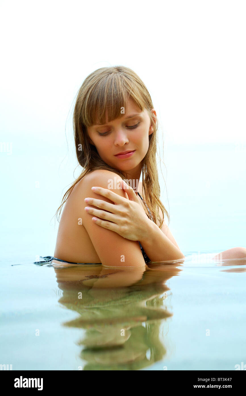 Portrait of fresh young girl in water - Stock Image