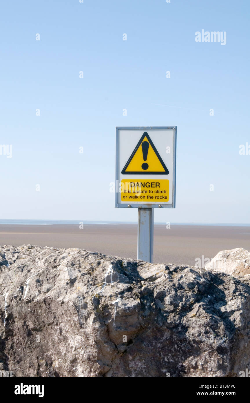 danger sign health and safety warning ! achtung exclamation mark  morecombe beach beaches dangerous sand sands tidal Stock Photo