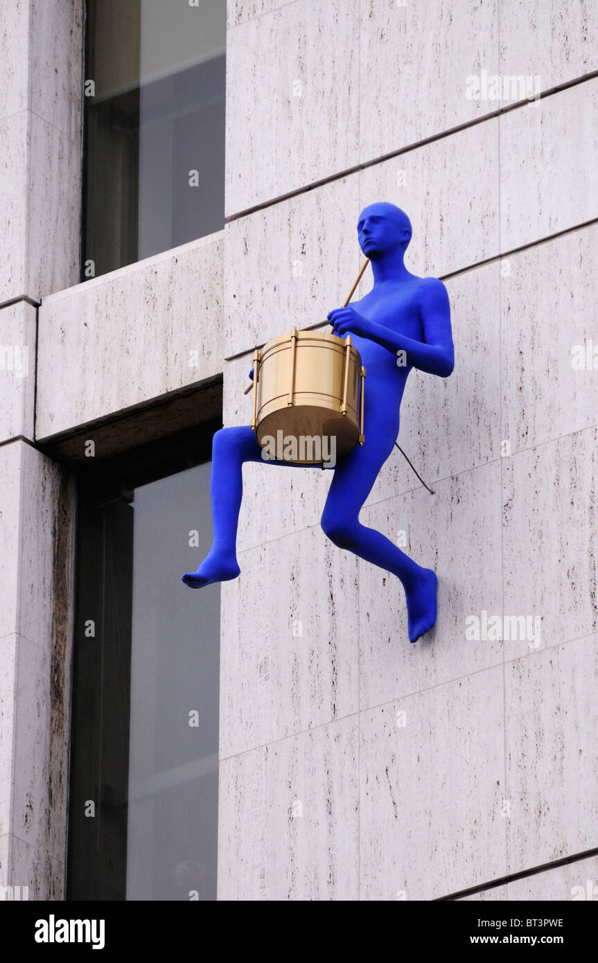 Scupture of a drummer on a building in Borough High Street, London, England, UK - Stock Image
