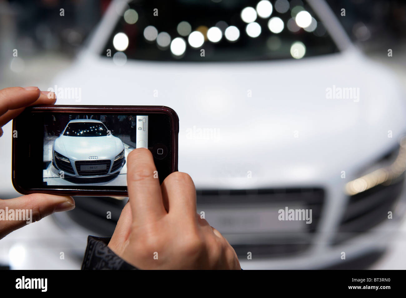 Visitor photographing Audi R8 GT at Paris Motor Show 2010 - Stock Image