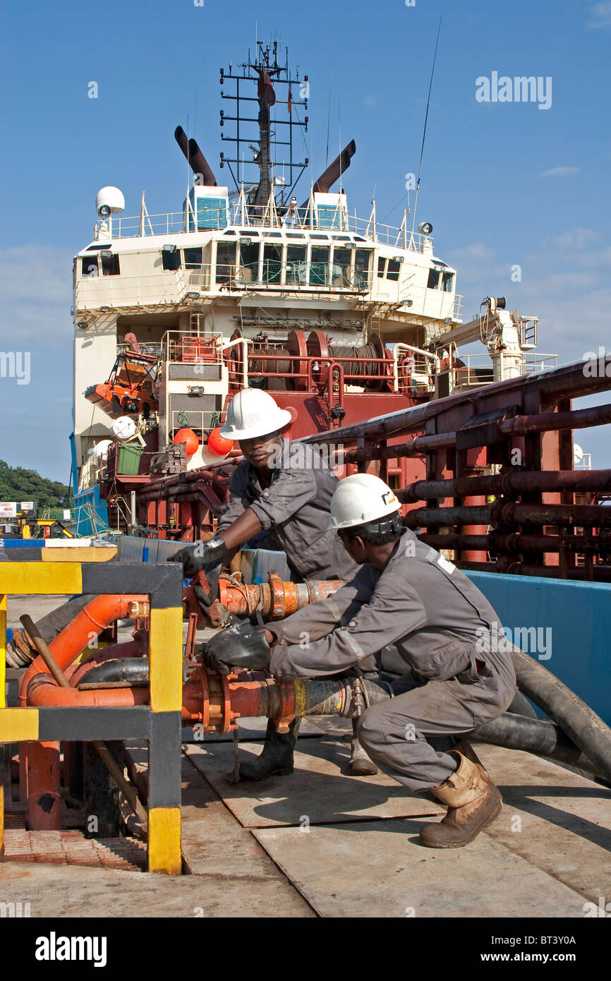 Luba Oil Freeport. Pumping barite dry chemicals via pipeline onto offshore oilfield supply boat for use in oil production - Stock Image