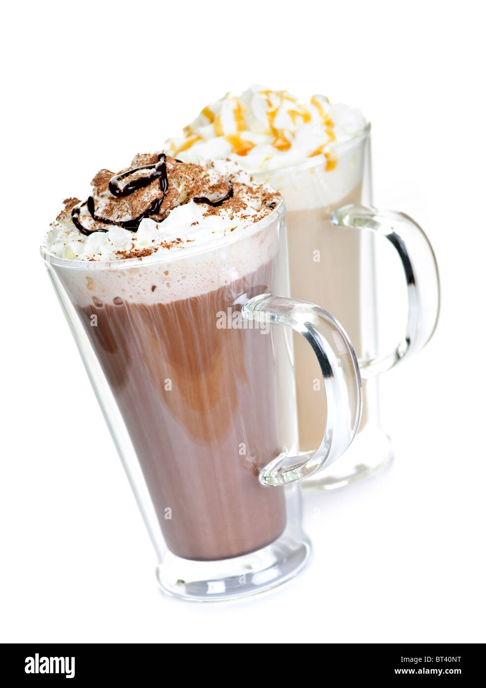 Hot chocolate and coffee beverages with whipped cream isolated on white background - Stock Image