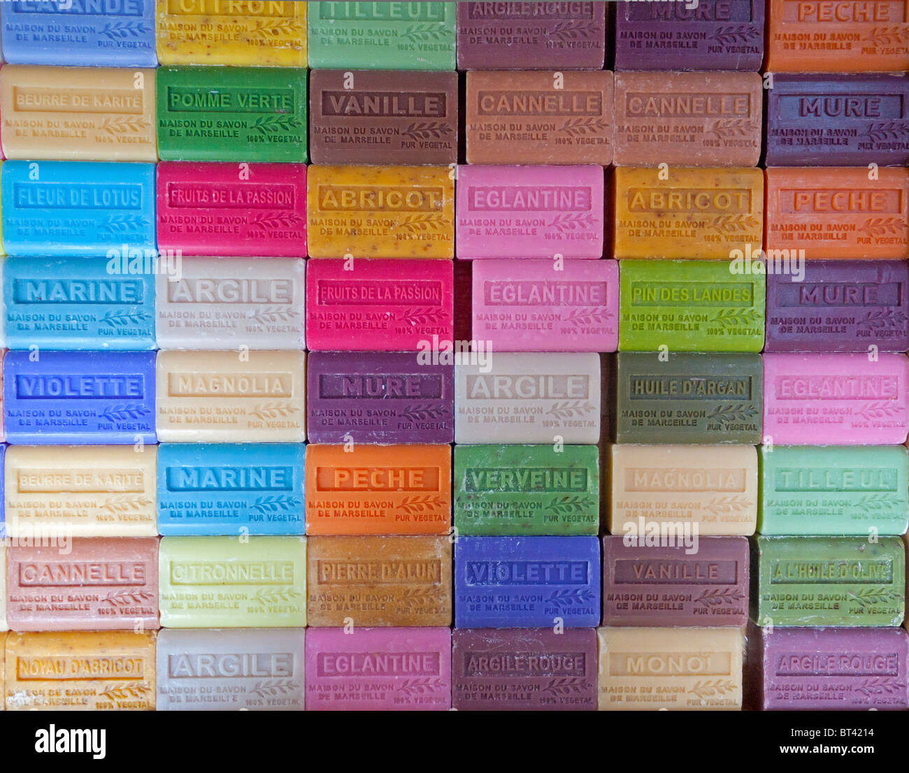 Detail of multi colored bars of soap on market stall in Bastille area of Paris France - Stock Image