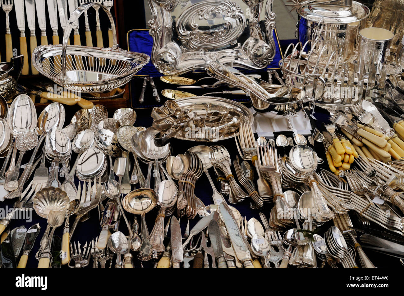 Silver Cutlery on a stall at Portobello Road Antiques Market, Notting Hill, London, England, UK - Stock Image