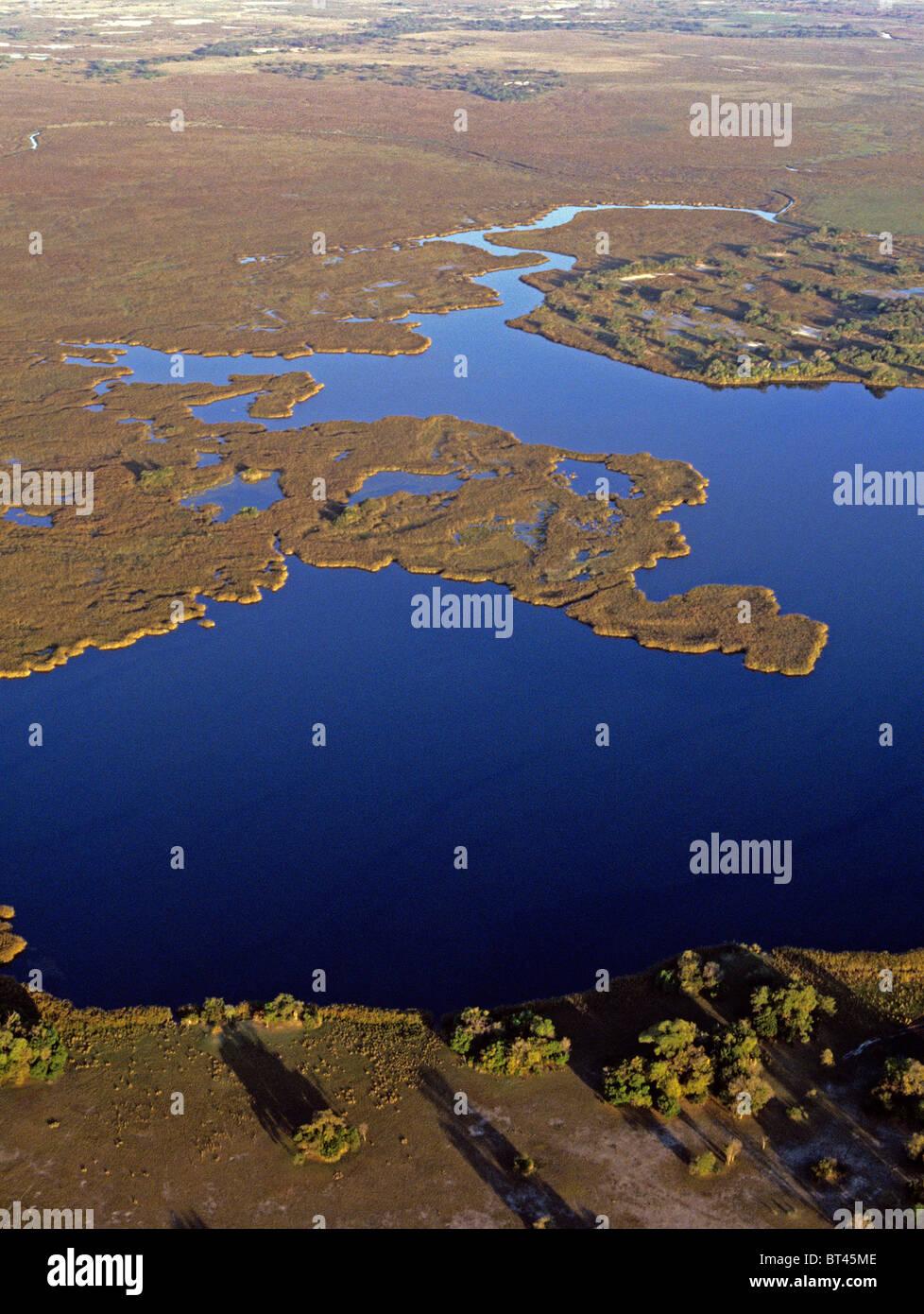 Last lagoon on the North-Western edge of the Okavango waters of Botswana - Stock Image