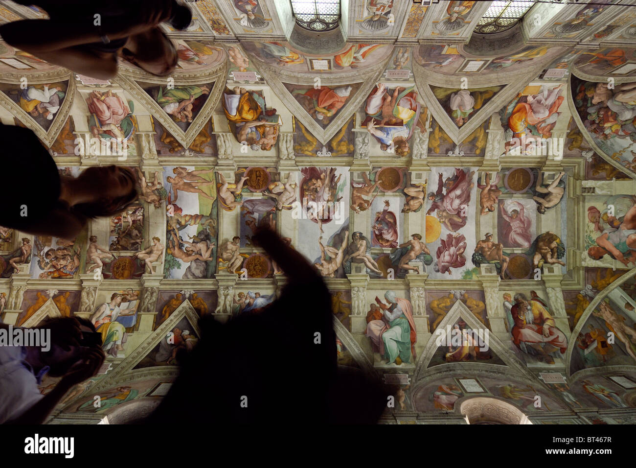 Rome. Italy. Tourists crowd the Sistine Chapel in the Vatican Museums. - Stock Image
