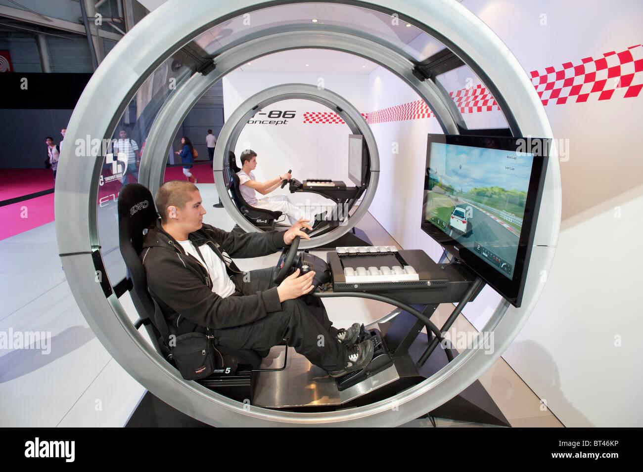 Visitors using Toyota driving simulators at Paris Motor Show 2010 - Stock Image
