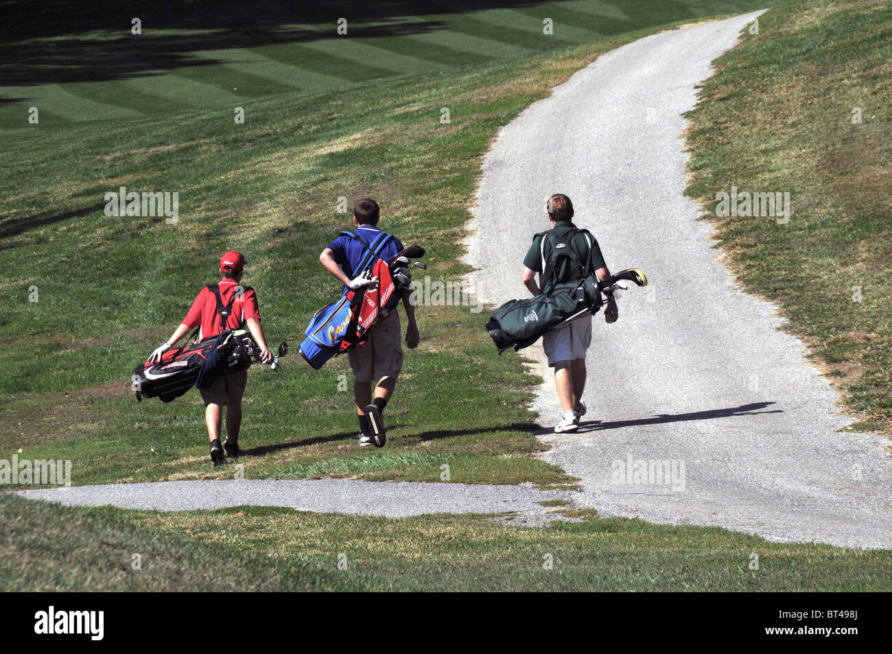 Golfers walking to their next hole to tee off - Stock Image