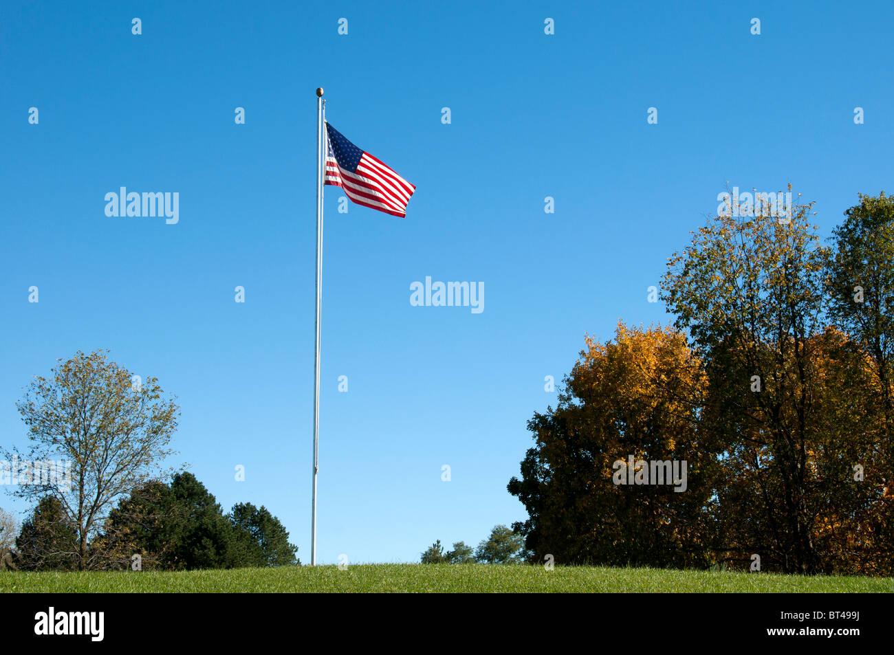 Flagpole on golf course. - Stock Image