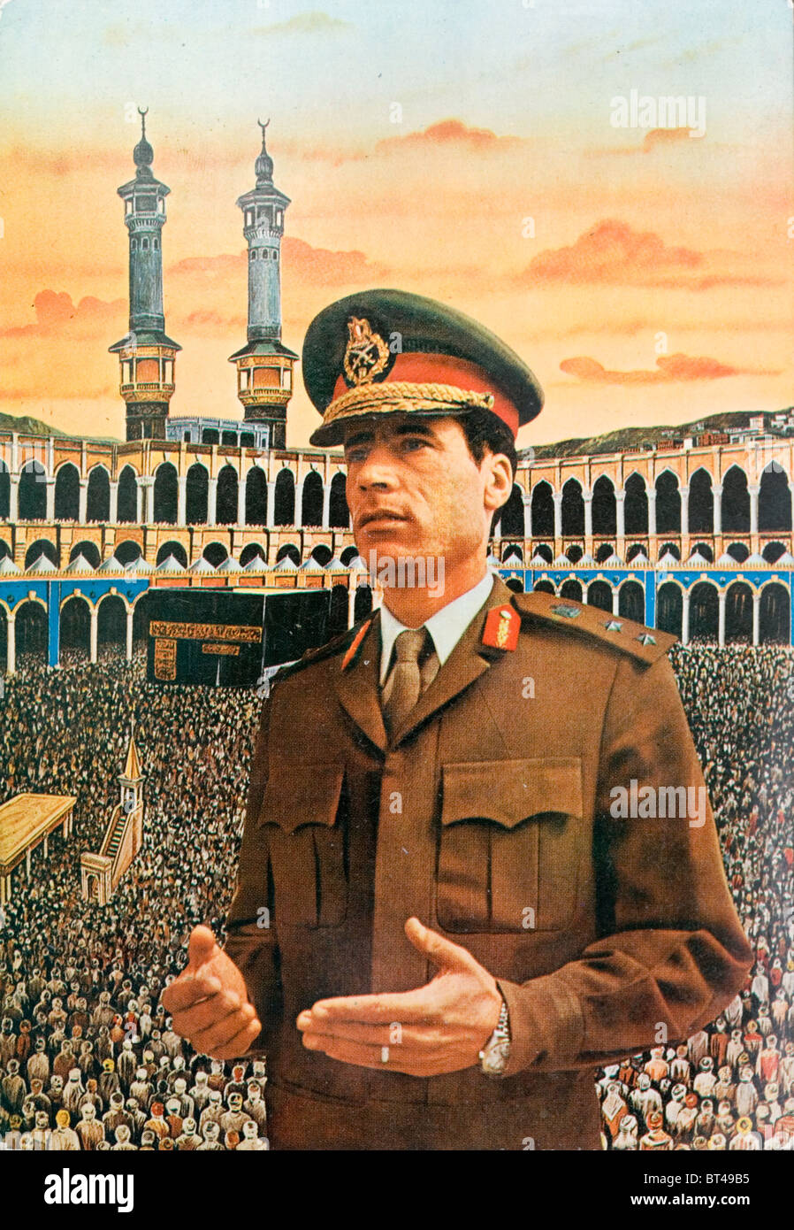 Montage postcard of Colonel Muammar al-Gaddafi pictured in front of a painting of a giant mosque with an enormous - Stock Image