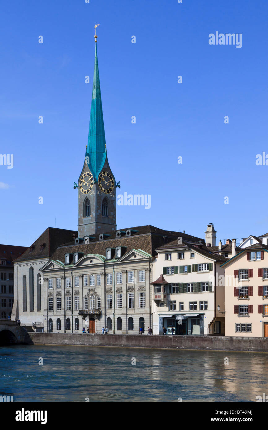 Looking across the Limmat river in Zurich at Fraumunster Abbey Church. - Stock Image