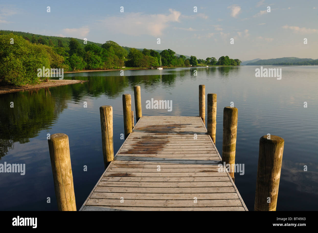 Jetty over Coniston Water in summer in the English Lake District - Stock Image