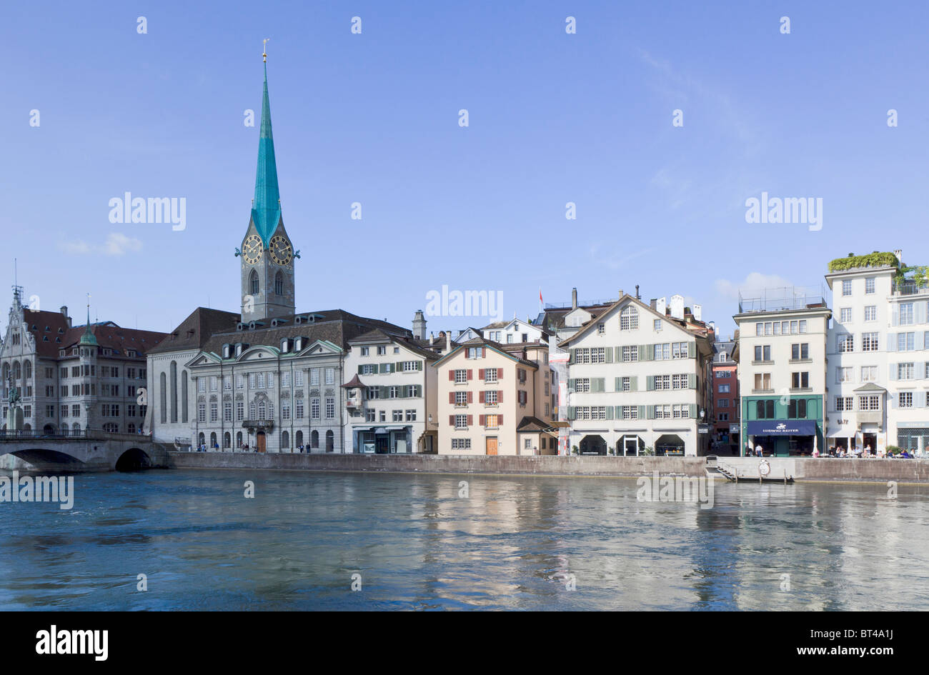 Looking across the Limmat river in Zurich at Fraumunster Abbey - Stock Image