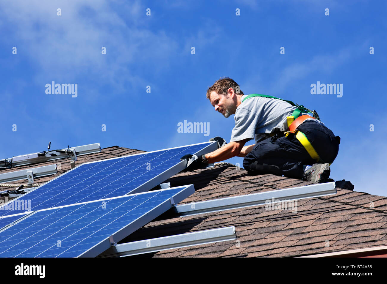 Man Solar Panel Stock Photos Images Alamy With Corrugated Thin Film Cells On Wiring Panels In Installing Alternative Energy Photovoltaic Roof Image