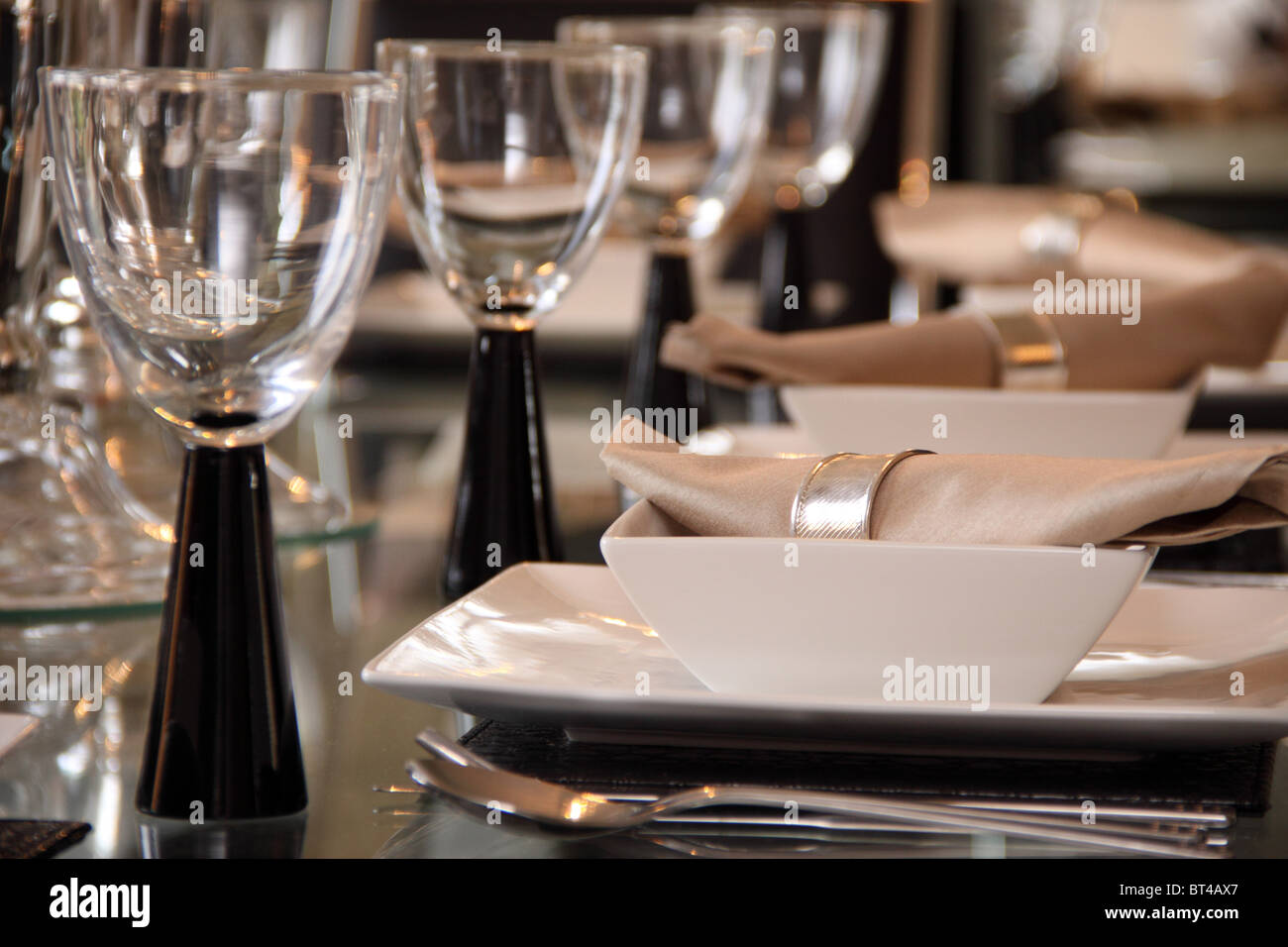 Dining table and glasses set for dinner - Stock Image