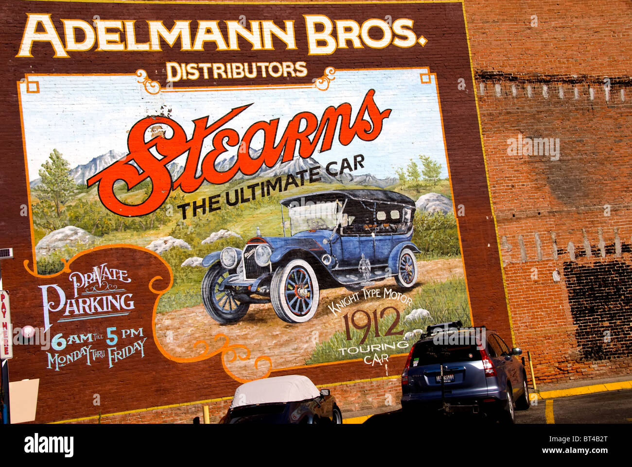 Mural of previous motor car company on side of Adelmann Building, Boise, Idaho - Stock Image