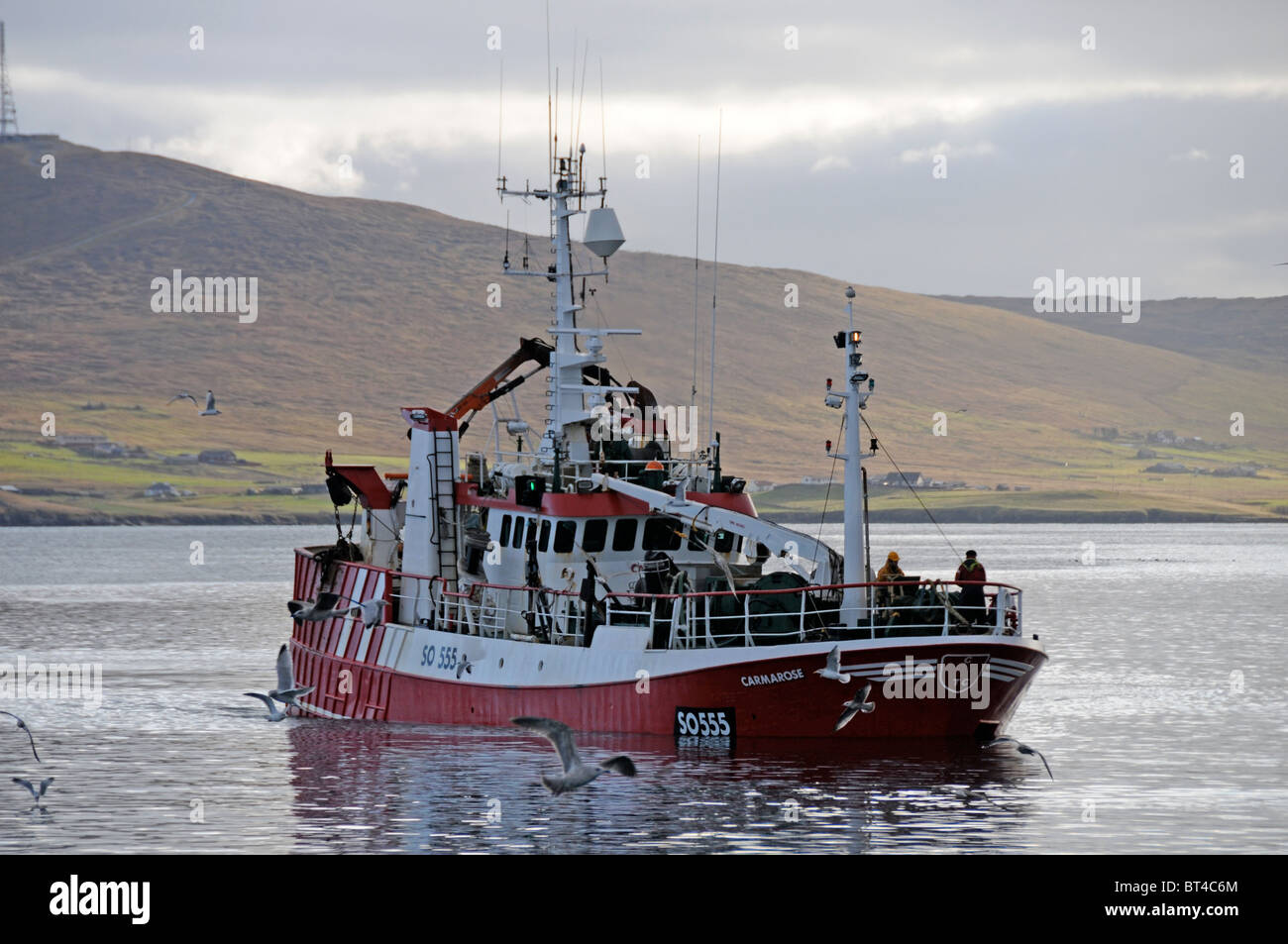 Fishing Boat laden down in the water with a large catch heading to Shetland Catch Shetland - Stock Image