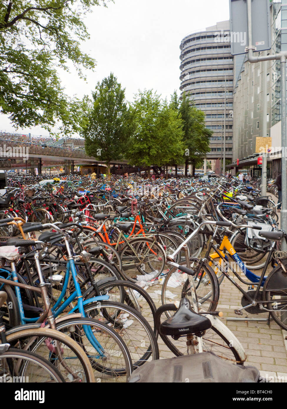 Amsterdam bicycle bike transport travel ride park windmill wind power energy electric generate urinal train station Stock Photo