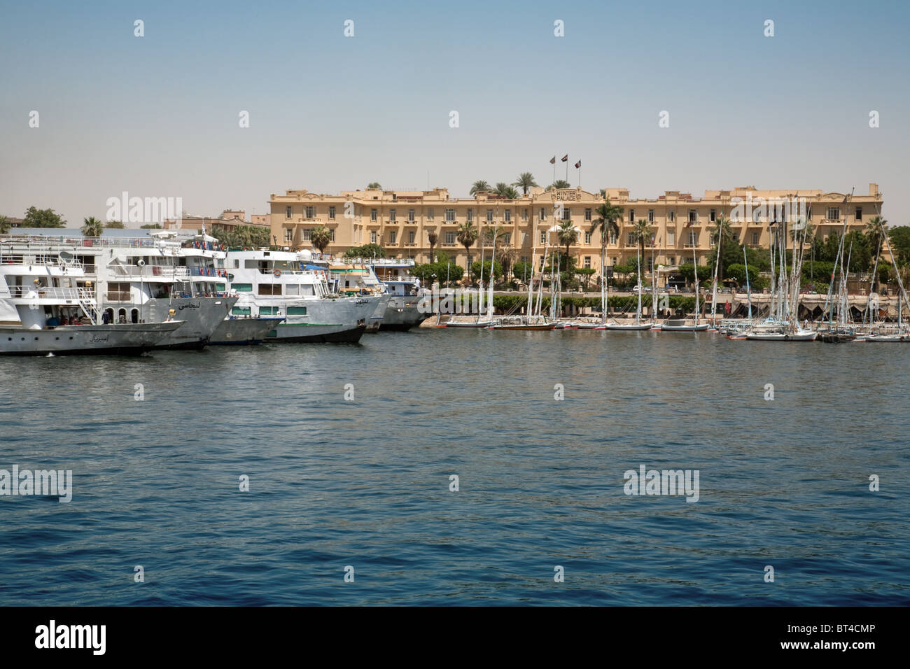 River Nile cruise ships moored at the Winter Palace Hotel, Luxor, Upper Egypt, Africa - Stock Image