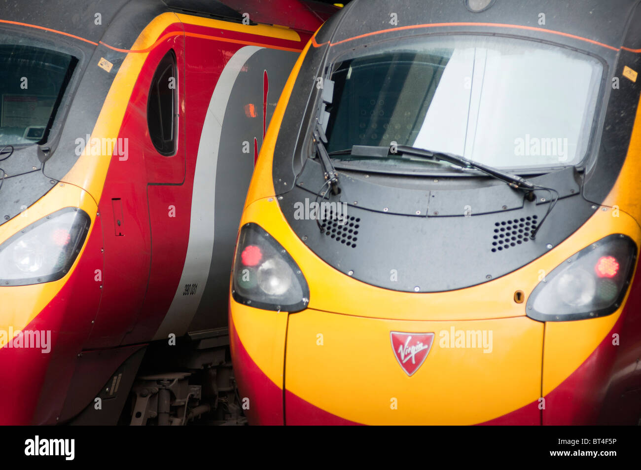Two Virgin train at the platform at railway station, London, UK - Stock Image