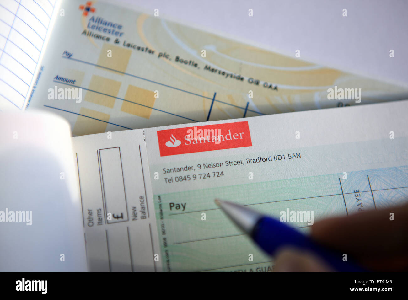 Santander cheque book following the acquisition and rebrading of Alliance & Leicester Building Society - Stock Image