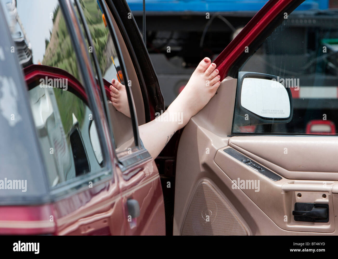 A Womanu0027s Foot Propped On A Car Door In South Dakota, June 3, 2010