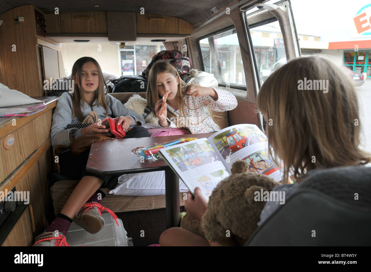 3 sisters in a VW campervan on holiday in France - Stock Image