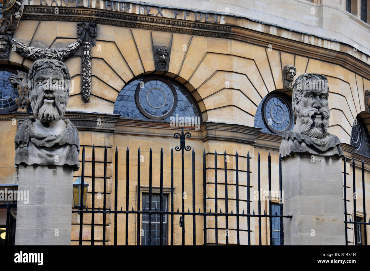 Gargoyles on railings outside the Sheldonian Theatre, Broad Street, Oxford Stock Photo