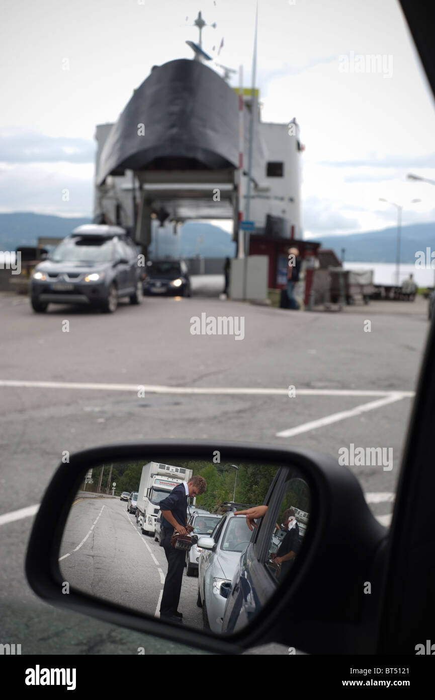 Car ferry, que, people paying for ride - Stock Image