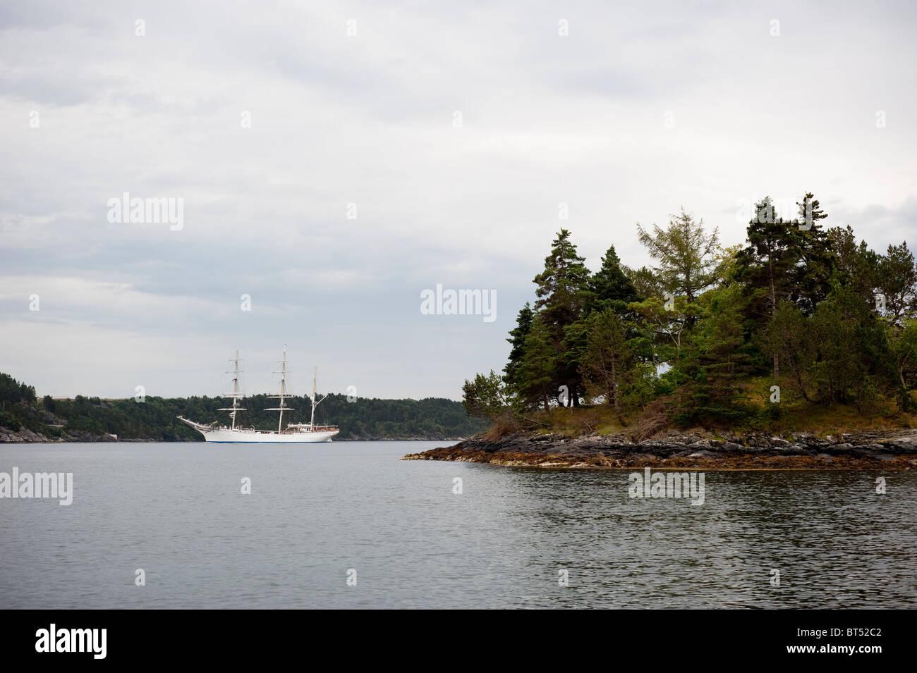 Old sailship in archipelago - Stock Image