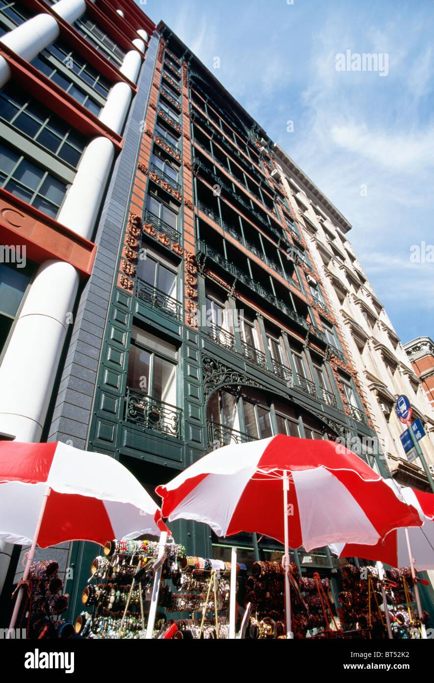 Sidewalk Vendors and Building Facades, SoHo, NYC - Stock Image