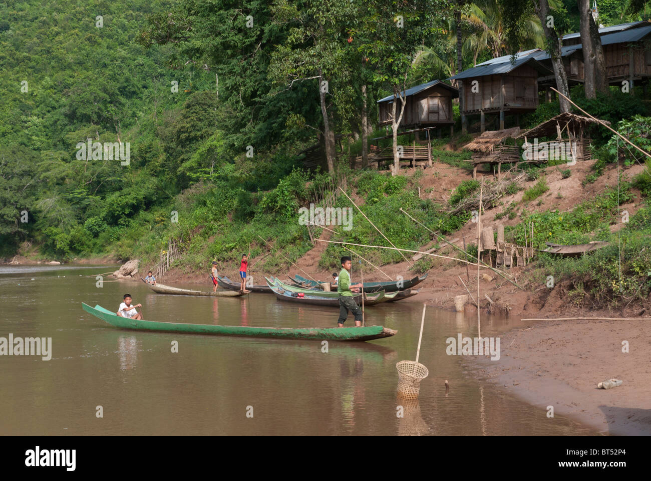 Tail Boat Trip along the Nam Tha River from to Paksa to Na Lae. Northern Laos Stock Photo