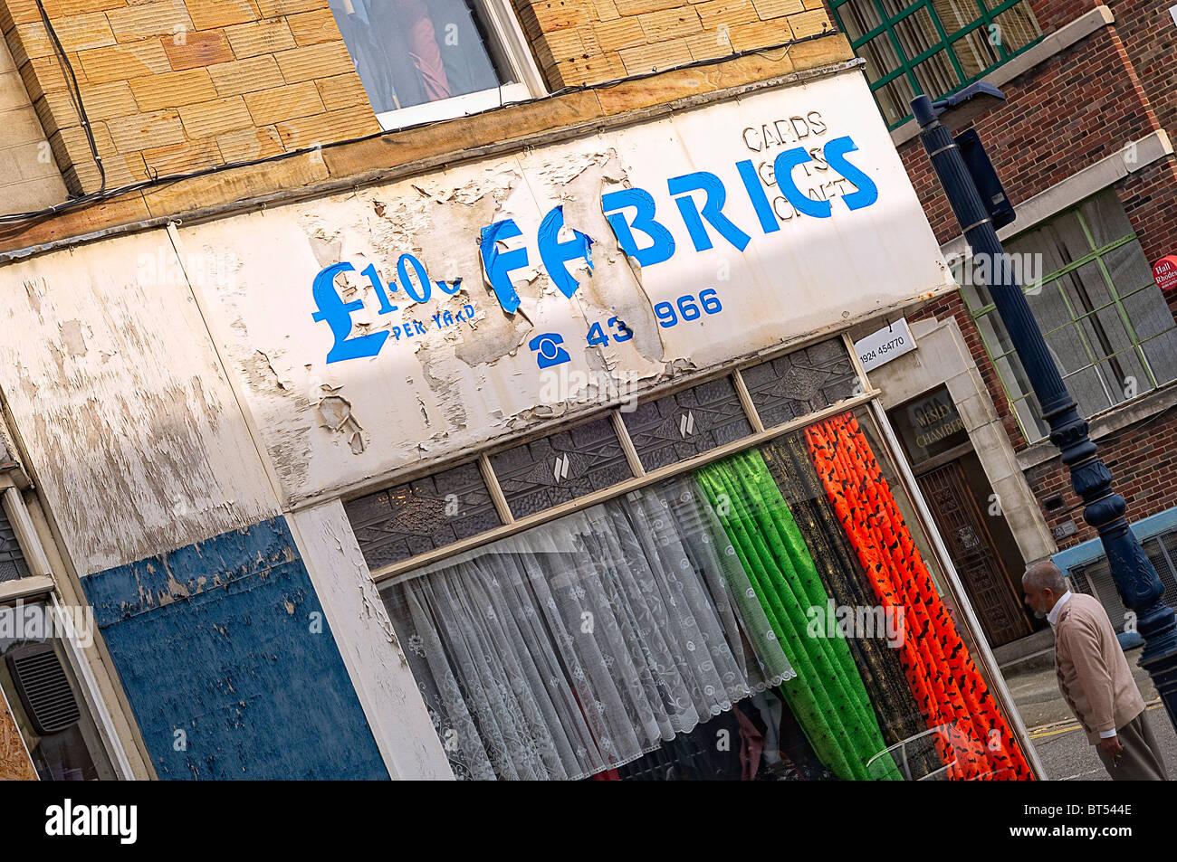 Run down fabric shop, Dewsbury, West Yorkshire UK - Stock Image