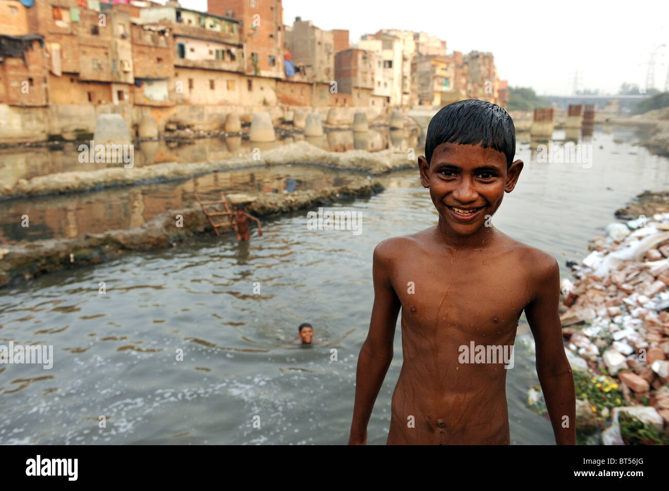 Children swimming in dirty water in India's capital New Delhi Stock
