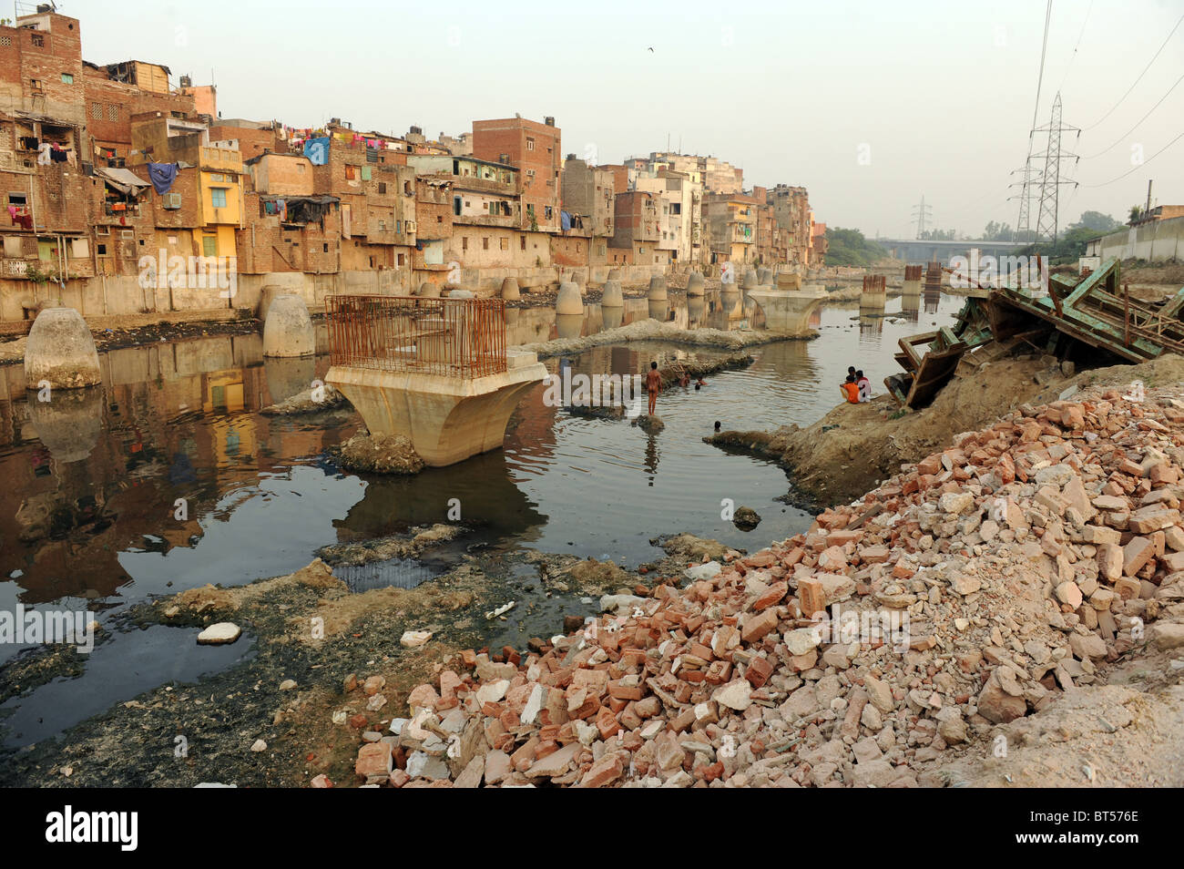 Children swimming in dirty water in India's capital New