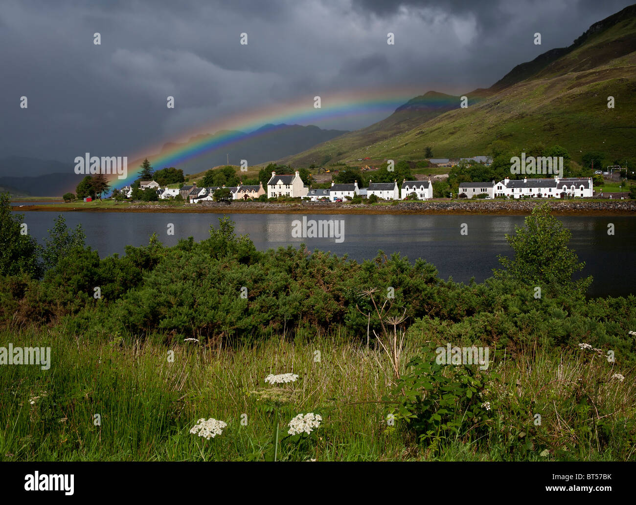 Rainbow over Dornie and Loch Long in the Western Highlands of Scotland - Stock Image