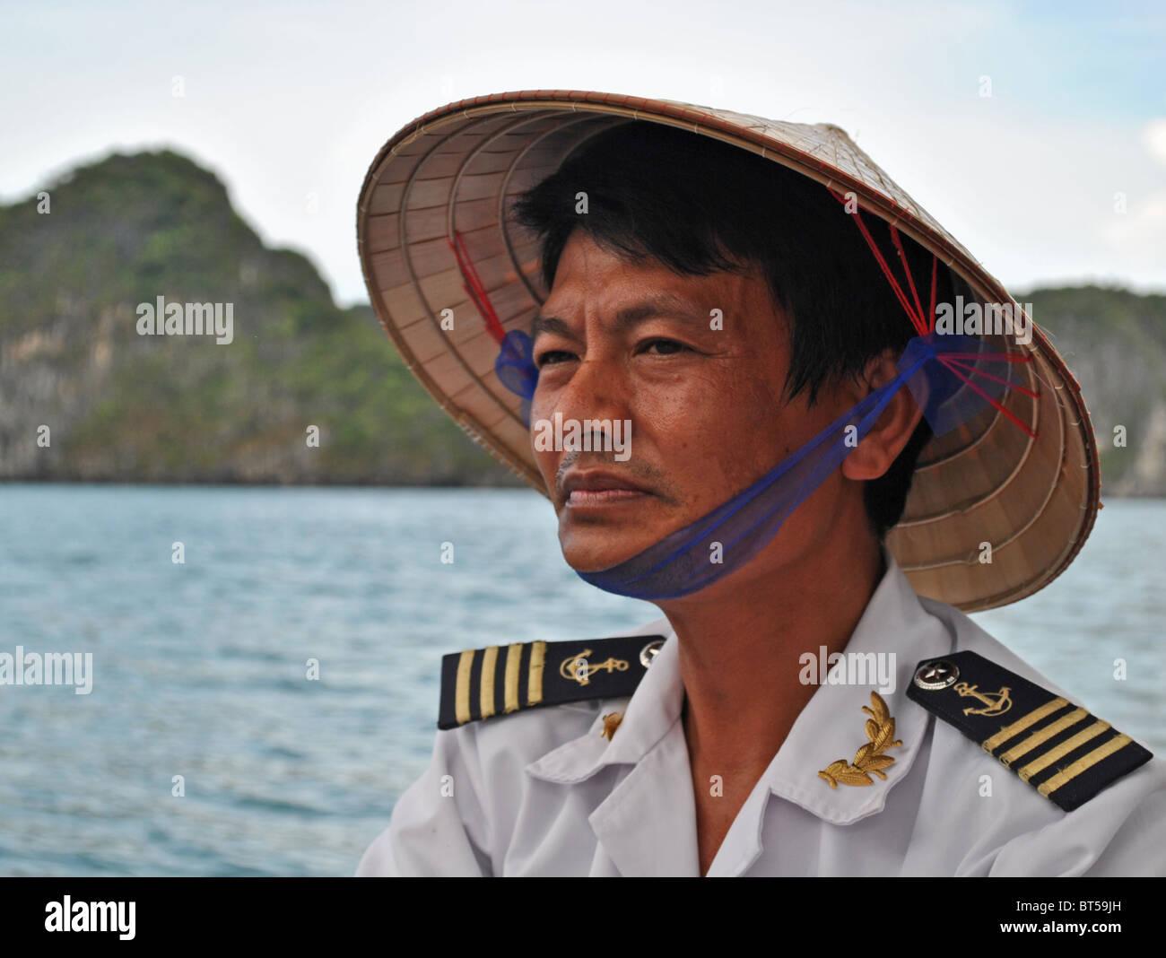 Boat captain in Halong Bay, Vietnam - Stock Image