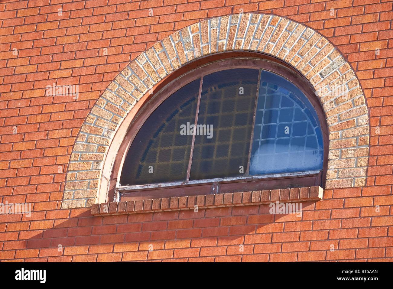 A Brick Wall Focus On A Half Moon Window Stock Photo Alamy