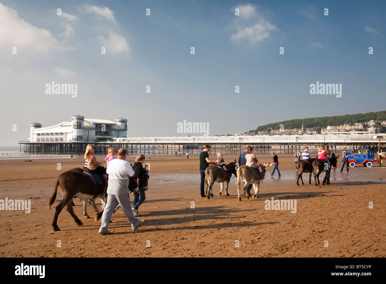 Traditional donkey rides on the beach at Weston-Super-Mare, Somerset, Uk - Stock Image