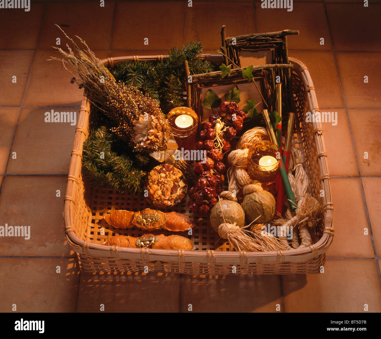 basket of dried herbs and spices with homemade christmas decorations