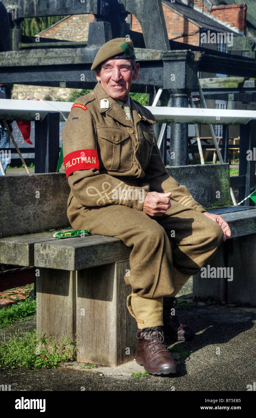 Re-enactor, dressed as a WW2 soldier, at the 'village at war' event at Stoke Bruerne, Northamptonshire UK - Stock Image