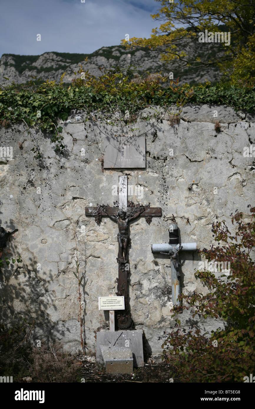 Abandoned gravesite, Saou Cemetery. - Stock Image