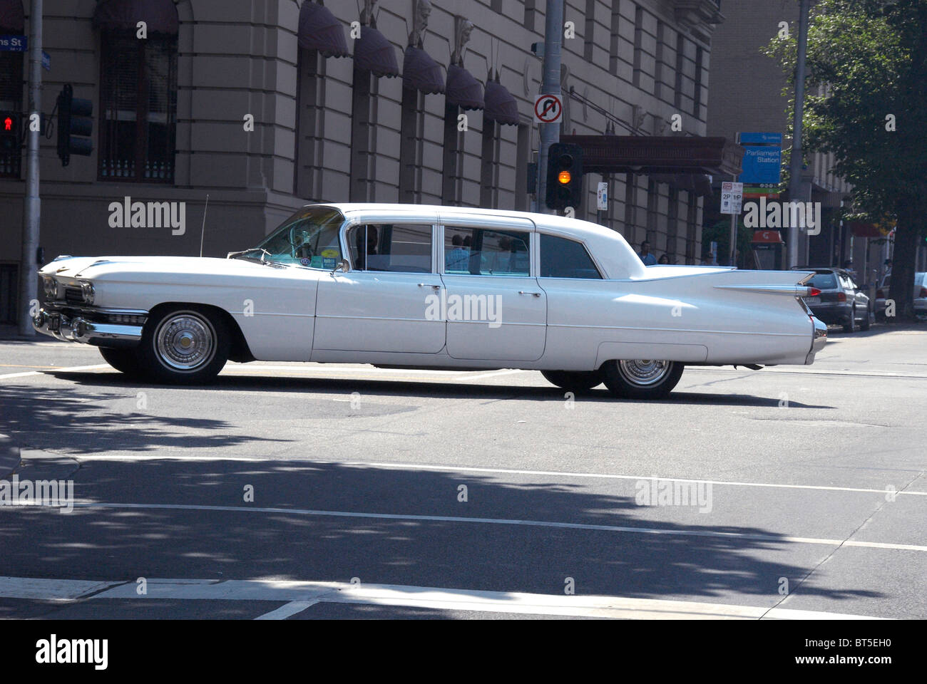 1964 White Classic Cadillac Sedan Deville car driving on a Melbourne street - Stock Image