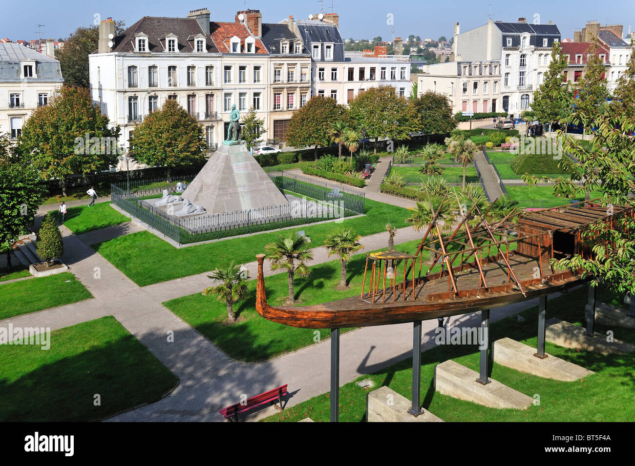 Replica of Egyptian wooden boat and statue of Auguste Mariette in city park at Boulogne-sur-Mer, France - Stock Image
