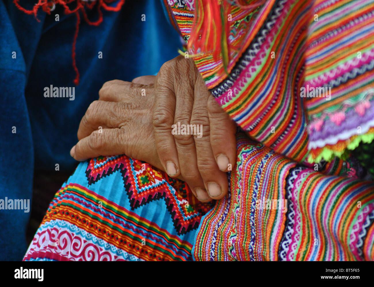 Detail of hands of an elderly 'Flower Hmong' tribal woman near Sapa, Vietnam - Stock Image