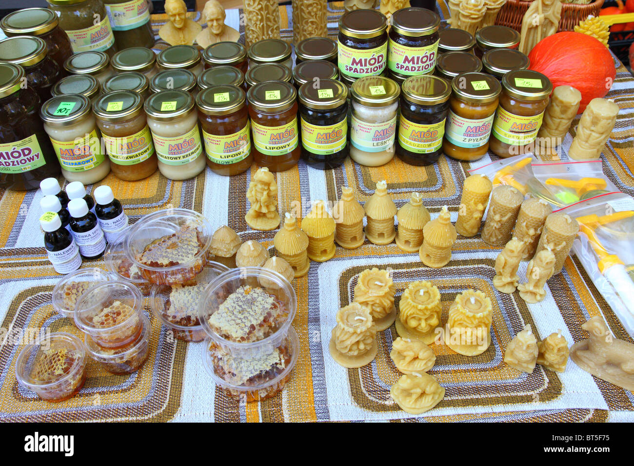 Jars of organic honey and home made beeswax products Wroclaw Poland - Stock Image