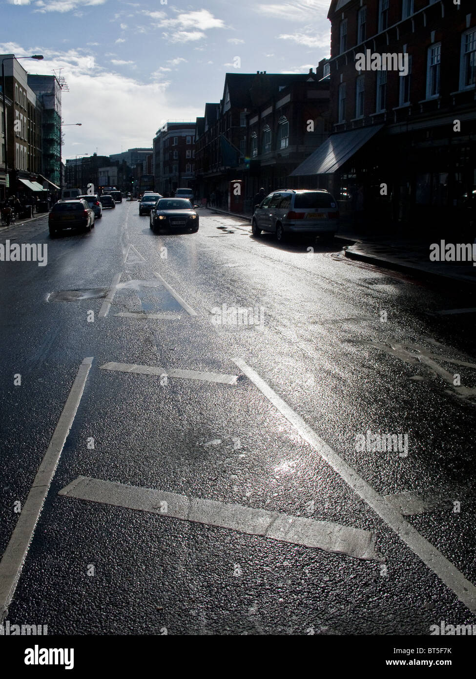 A road in London after heavy rain.  Photo by Gordon Scammell - Stock Image