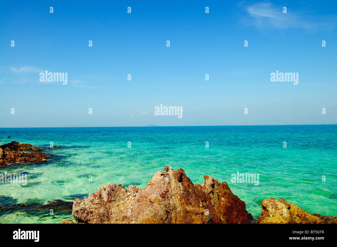 Tropical landscape - sea shore on desert island - Stock Image